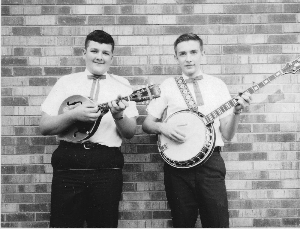 Tony Williamson holds his mandolin next to his brother Gary, pictured with a banjo in 1965.