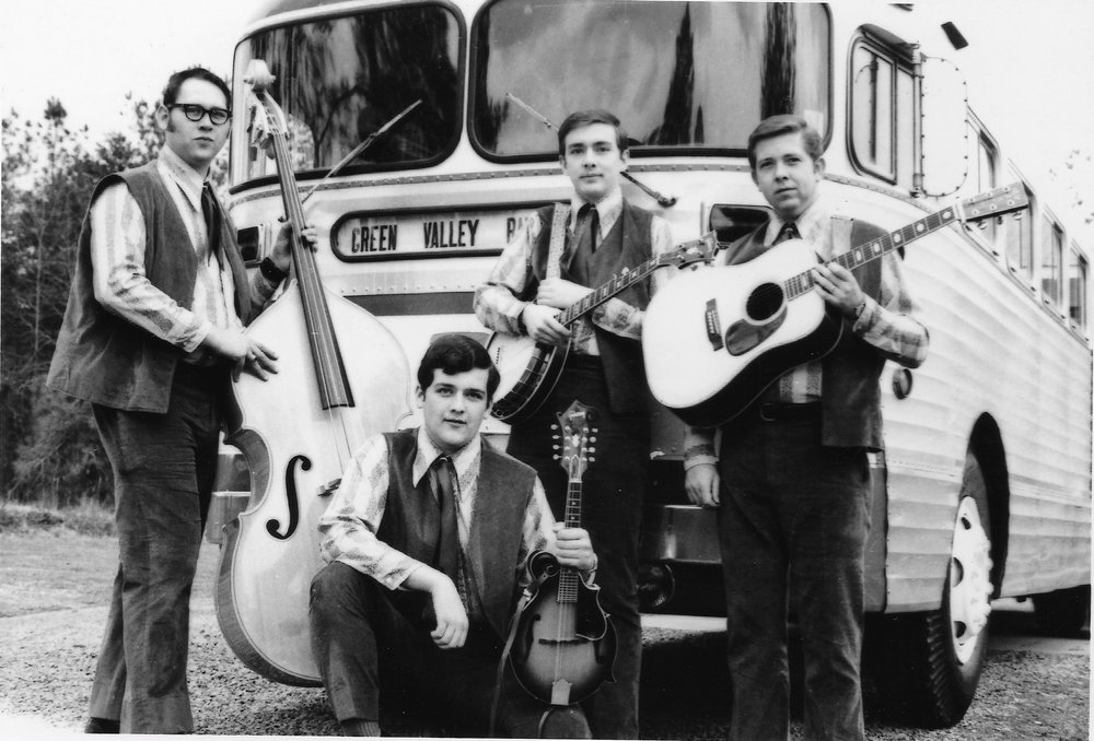 Tony Williamson, pictured kneeling in front with his mandolin, and the Green Valley Ramblers.
