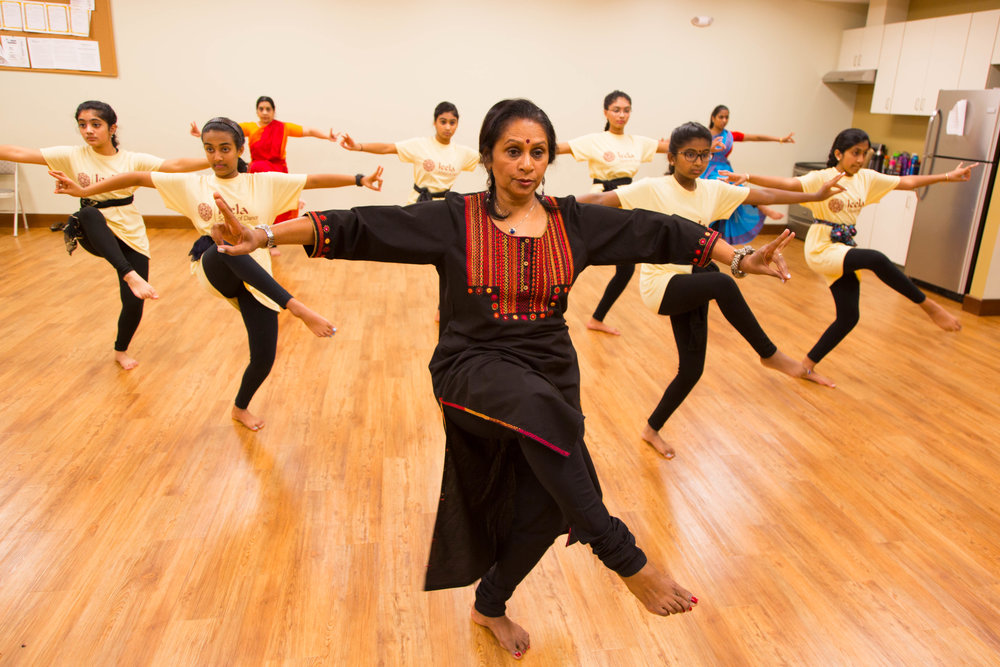 Asha Bala dancing with her students.
