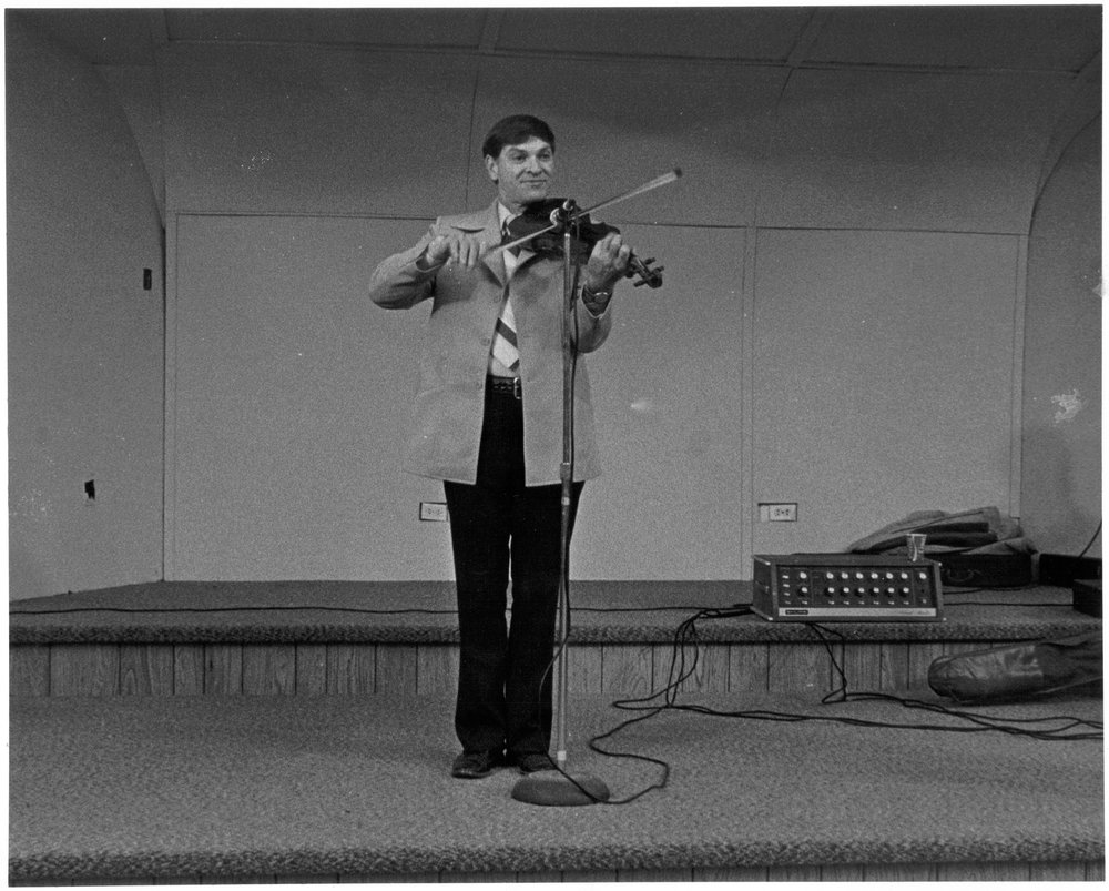 Arvil Freeman playing fiddle, circa 1960.