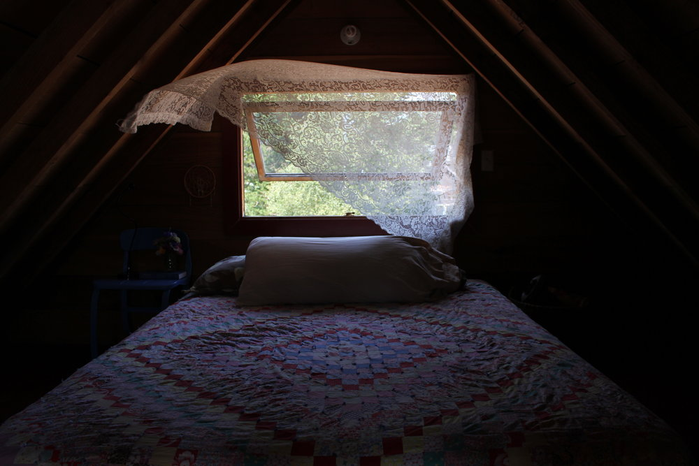 crochet curtain and quilt at plum nelli rustic boho cabin.JPG