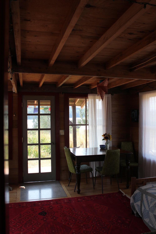 rustic cabin living dining room persian carpet.JPG