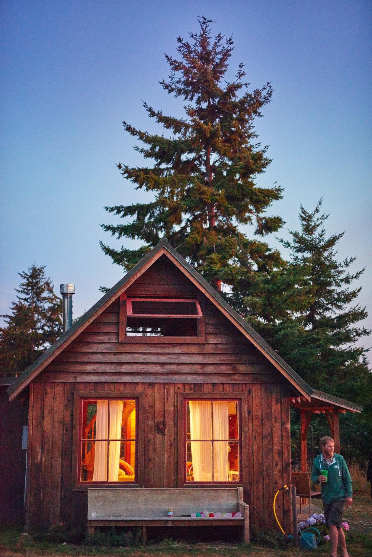 plum nelli homestead tiny home cabin at night.jpg
