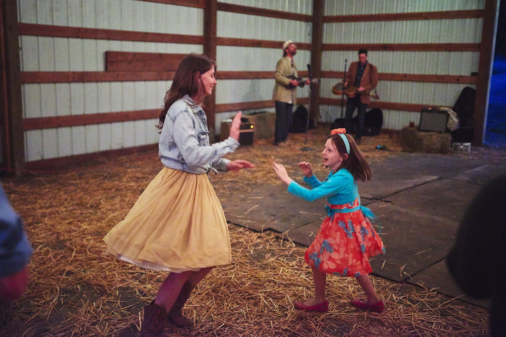 line dancing at plum nalli farm barn wedding.jpg