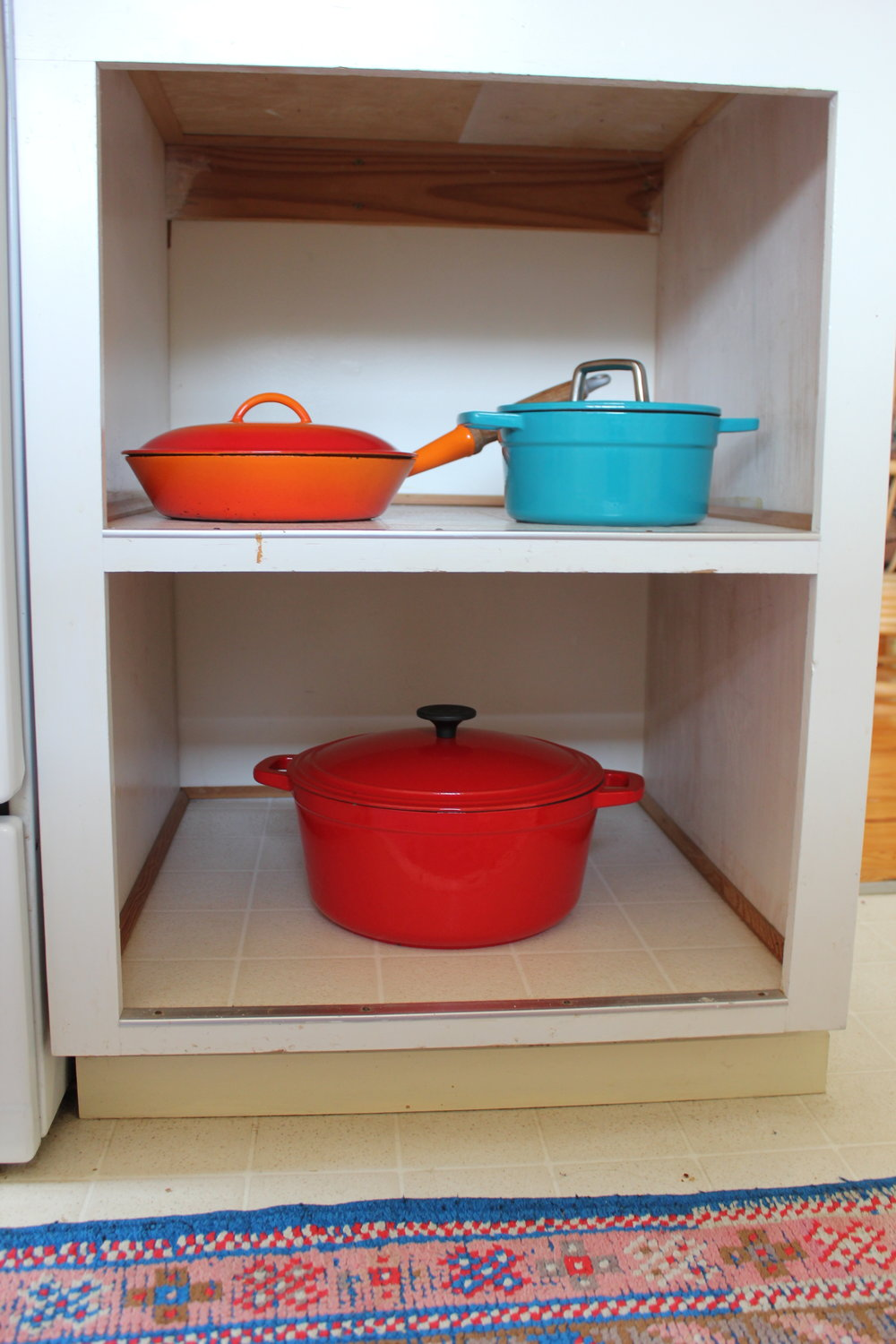 colorful cast iron pots and pan at plum nelli vintage far chic abode.JPG