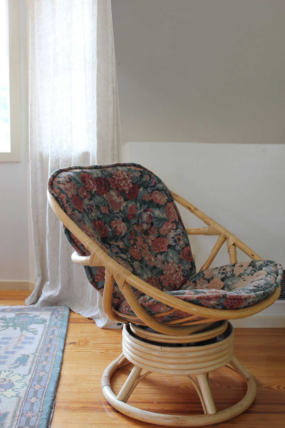 vintage rattan and floral rocking chair at plum nelli farm chic apartment rental airbnb.JPG