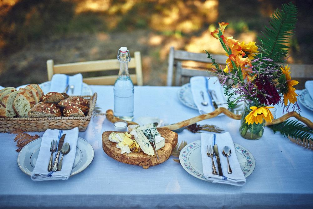 plum nelli outdoor wedding dinner table setting.jpg