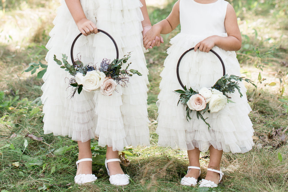 I am completely obsessed with the floral hoop trend, I hope it stays around for a while! These two cuties are our two of our nieces, Maddy (L-7yrs) & Emma (R-4yrs), they carried these for all of group photos, swapping them out only for the ceremony to drop fresh rose petals.  Floral Hoops |  Allium Floral   Image by Grace |  True Grace Creative