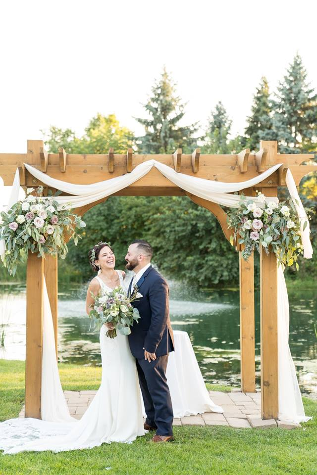 """Briana & Carmen September 14, 2018 - """"I didn't take much time to shop around for florist. Kim was recommended to me by my cousin who also used her services for her wedding. Once I met up with Kim and discussed what I had in mind there was no turning back. She was able to make my idea come to life. We discussed different options to use, artificial or real, and what would look better. I had a small budget and she was able to work with me. I even provided some elements of my own for the centerpiece that turned out amazing! She made me a beautiful headpiece as well. I focused on succulents because it went with the feel I was going for and she was beyond able to make my vision reality. """" - Briana as reviewed on WeddingWire"""