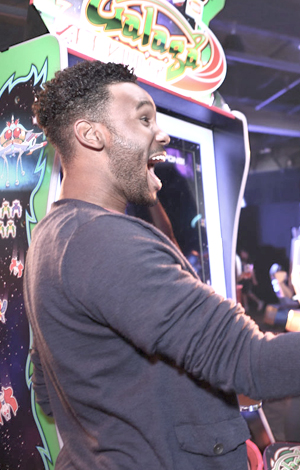 Ecstatic male at an arcade