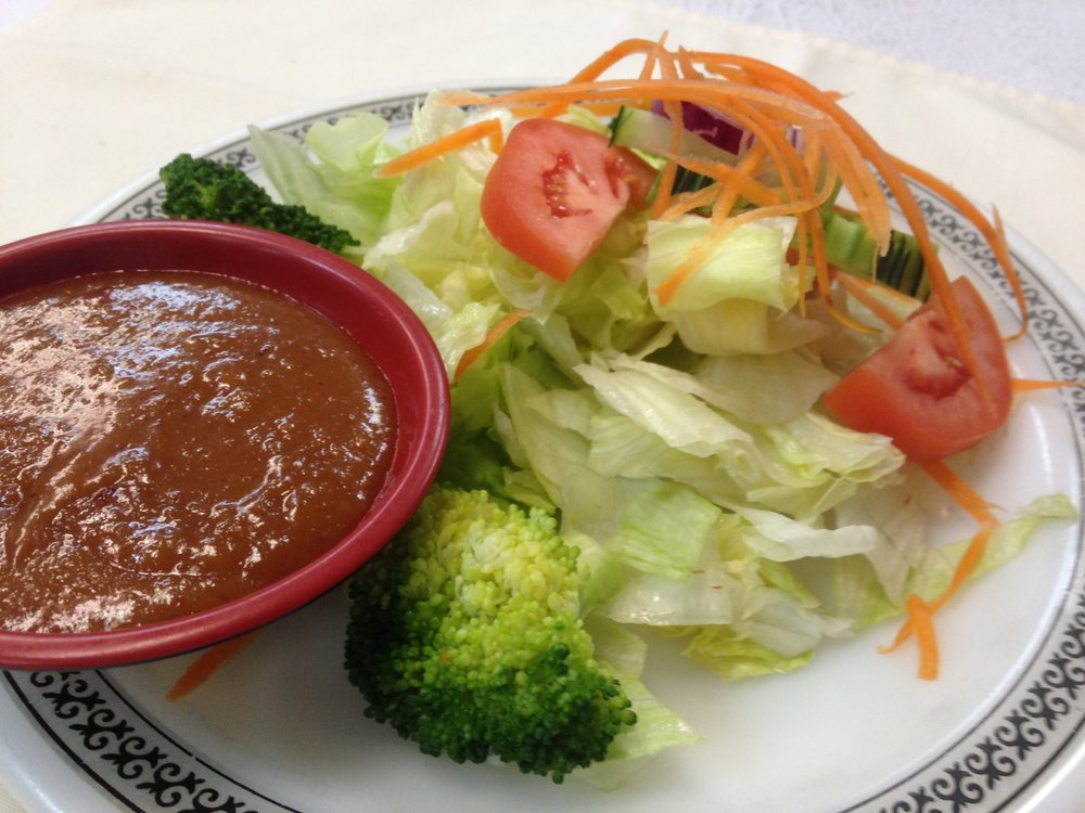 house salad - Fresh lettuce, carrot, cucumber, tomato, broccoli and red onion. Served with ranch dressing or peanut sauce   4.00