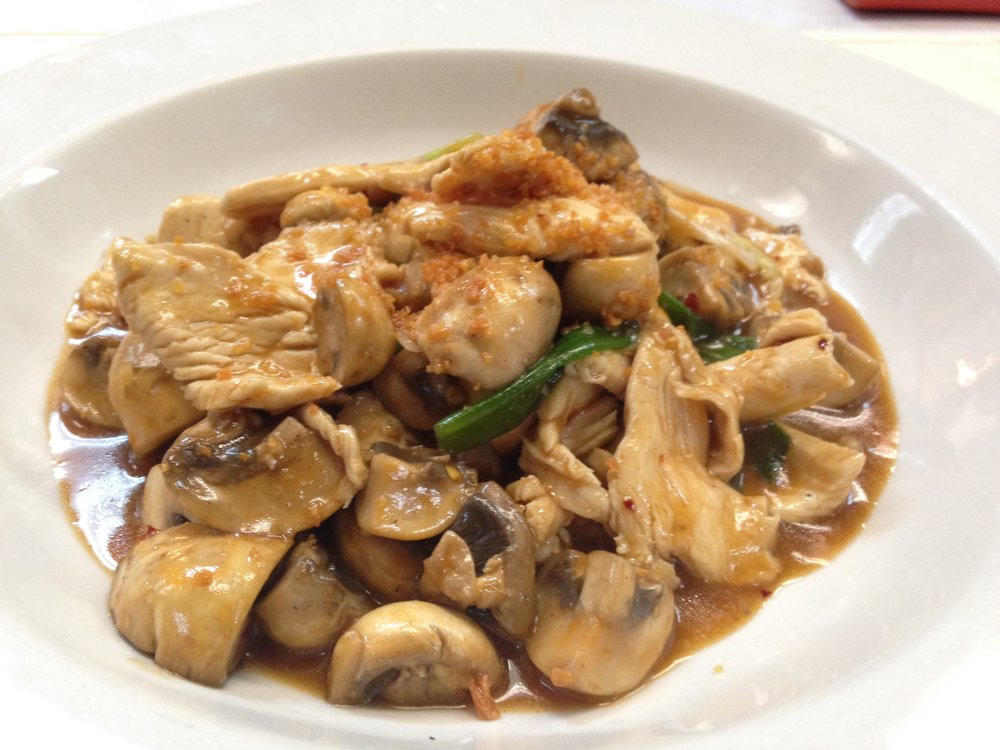 garlic w/chciken -    Stir fried with fresh garlic, mushroom and green onion with garlic sauce, served with rice   7.25 / 10.95