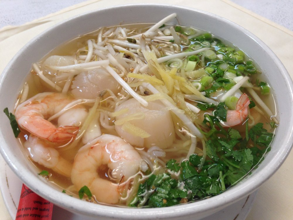 Seafood Noodle Soup - Shrimp, scallop, imitation crab meat,rice noodle, bean sprout, green onion and cilantro in Thai ginger broth   9.95 / 13.95