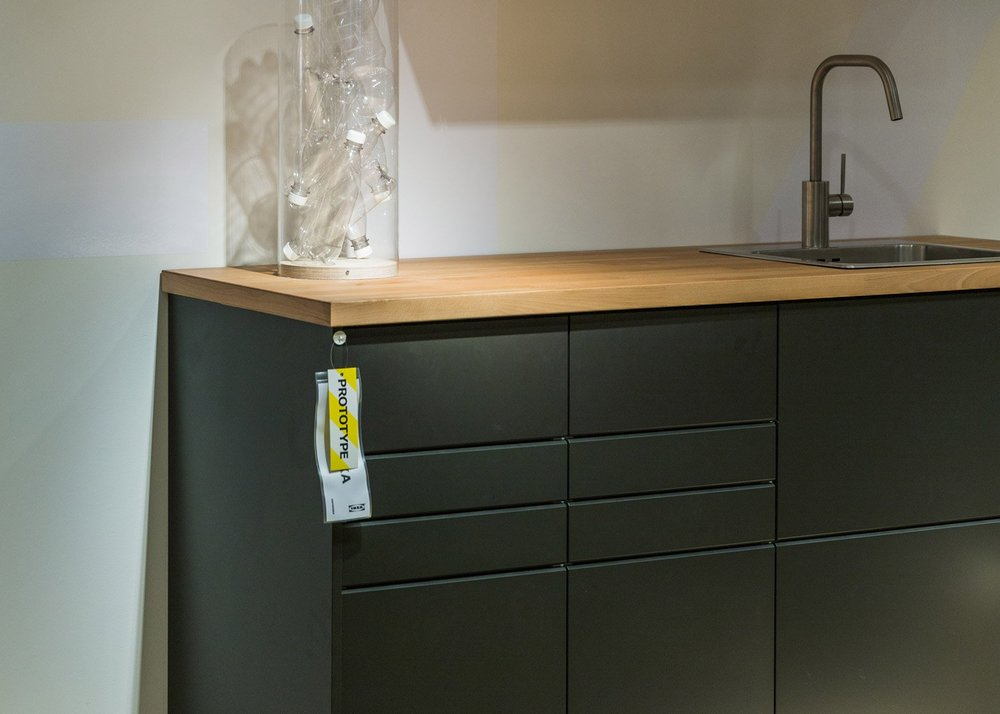 Fig 2.  'Kungsbacka' kitchen cabinet doors made from recycled PET plastic bottles and wood,https://www.dezeen.com, Accessed March 23, 2017. https://www.dezeen.com/2016/06/16/ikea-ps-2017-collection-no-waste-products-furniture-recycled-materials-post-scriptum/.