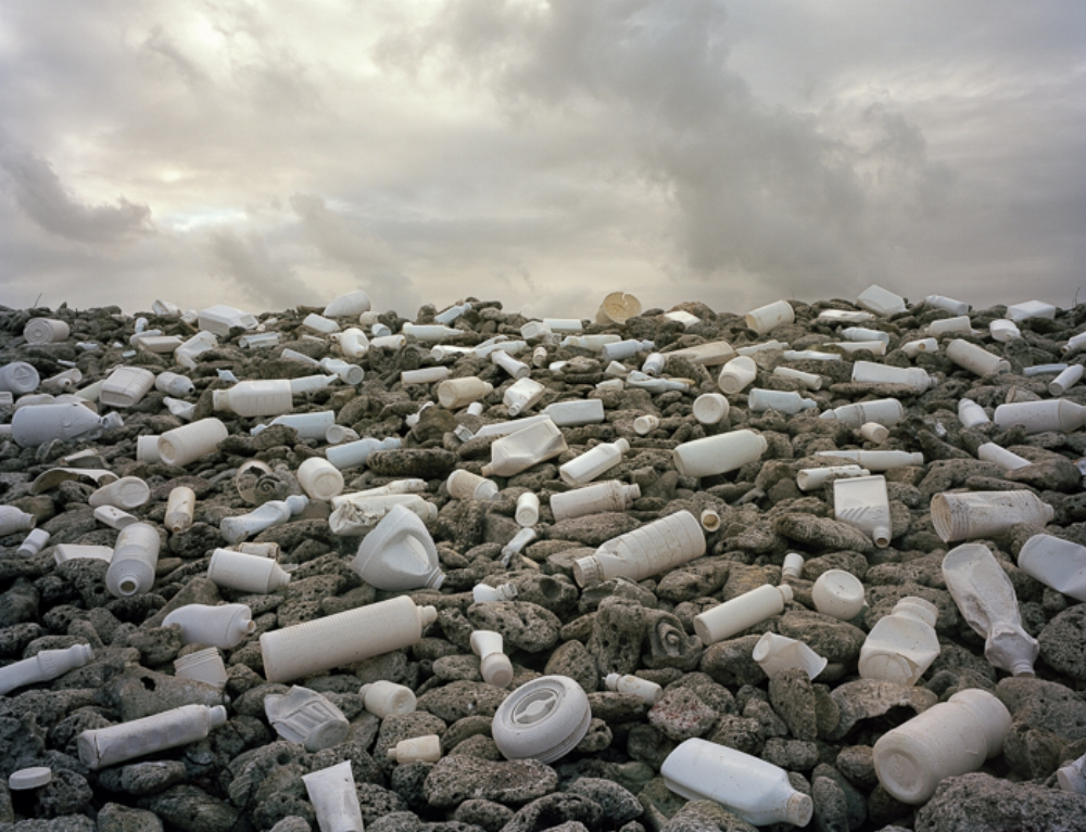 """Fig 1 . Duran, Alejandro. """"Nubes (Clouds)"""" Washed Up Accessed August 17 2017.http://www.alejandroduran.com/.  This photograph was taken as part of Duran's photography project  """"Washed Up""""  that transforms the international debris washing up on Mexico's Caribbean coast into aesthetic yet disquieting works."""