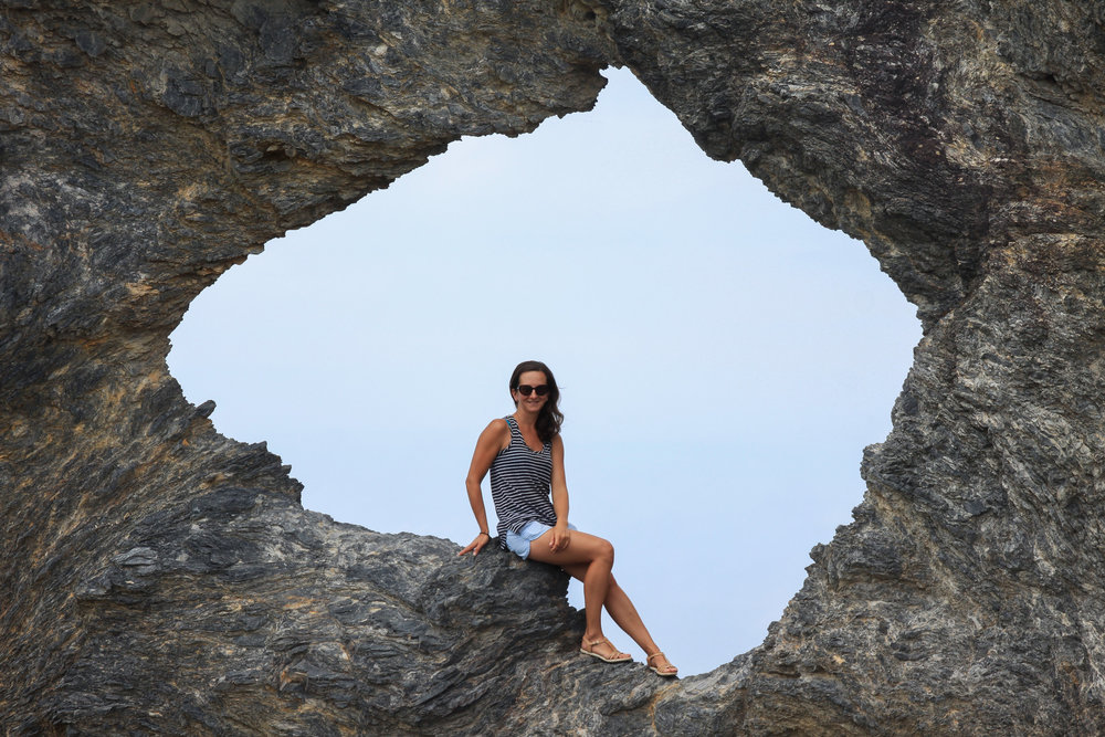 Female sitting in Australia shaped rock