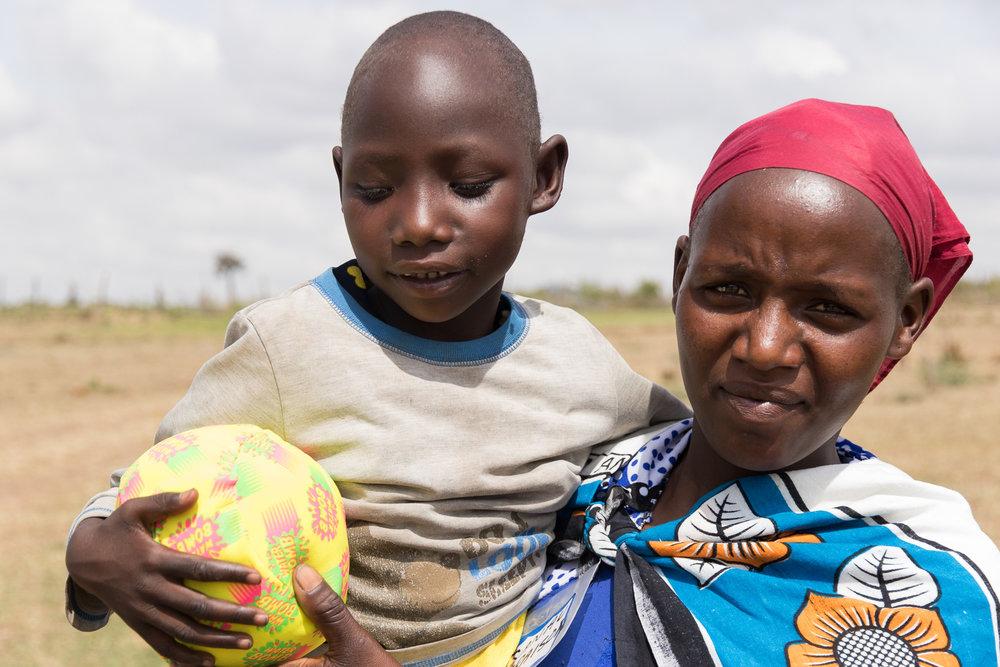 kenyan maasai mother with young child