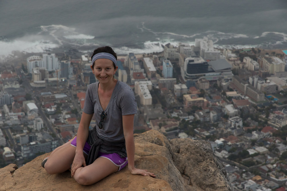 female hiker at the top of lion's head