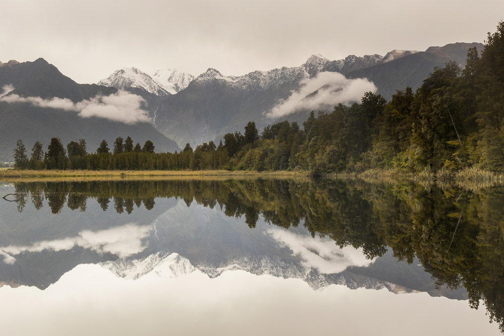lake reflection of mountains and trees