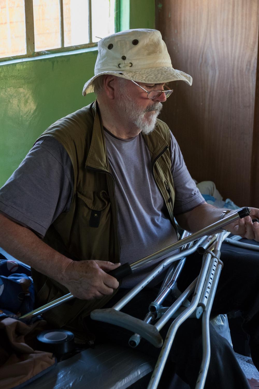 Canadian volunteer fixing crutches