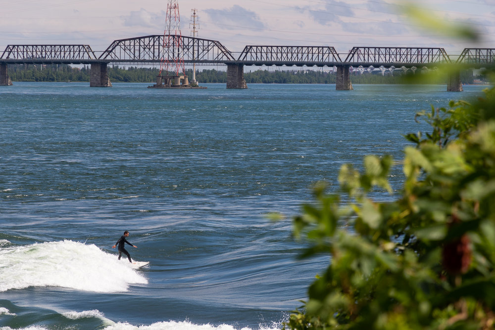 male surfer river surfing in montreal canada