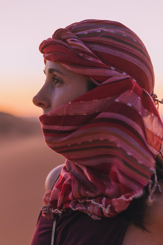 portrait of female traveler in the sahara desert at sunset