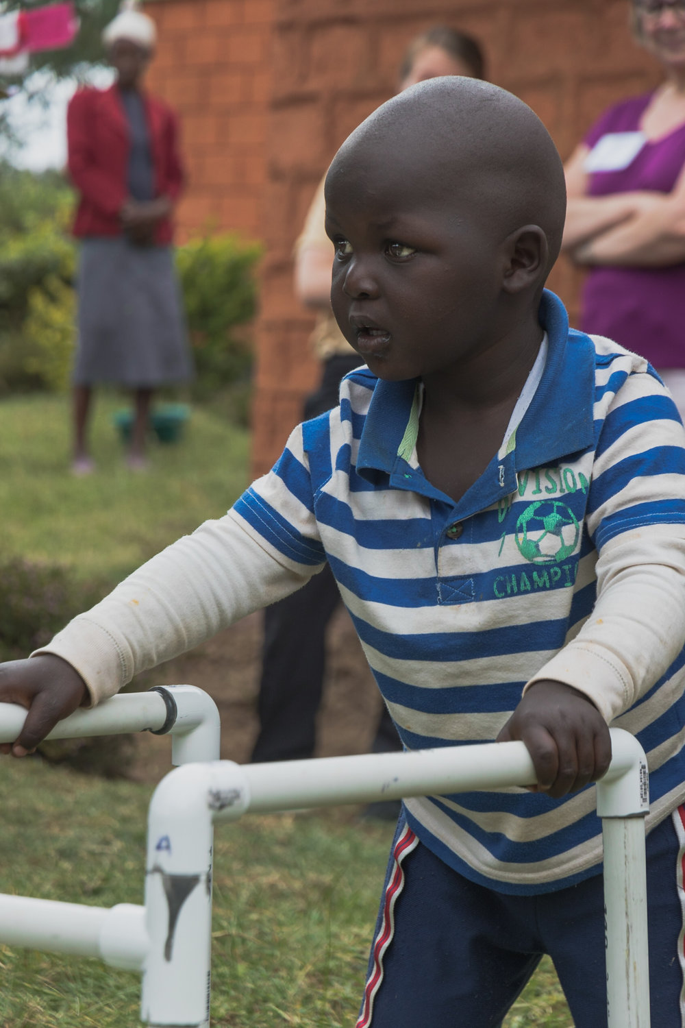young Kenyan boy receiving physical therapy