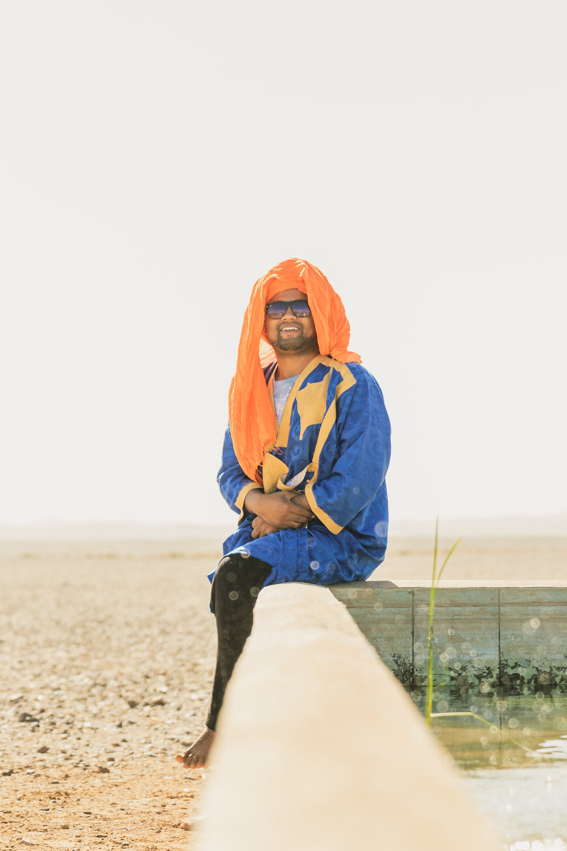 moroccan tour guide posing in the sahara desert