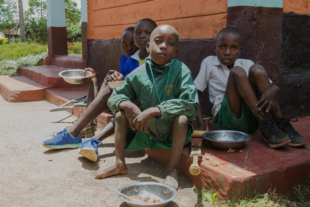 schoolchildren having lunch outdoors in kenya