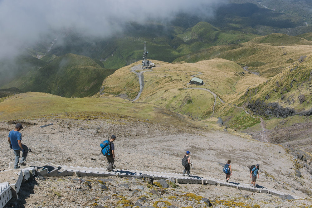 group of hikers heading down mount Taranaki in New Zealand