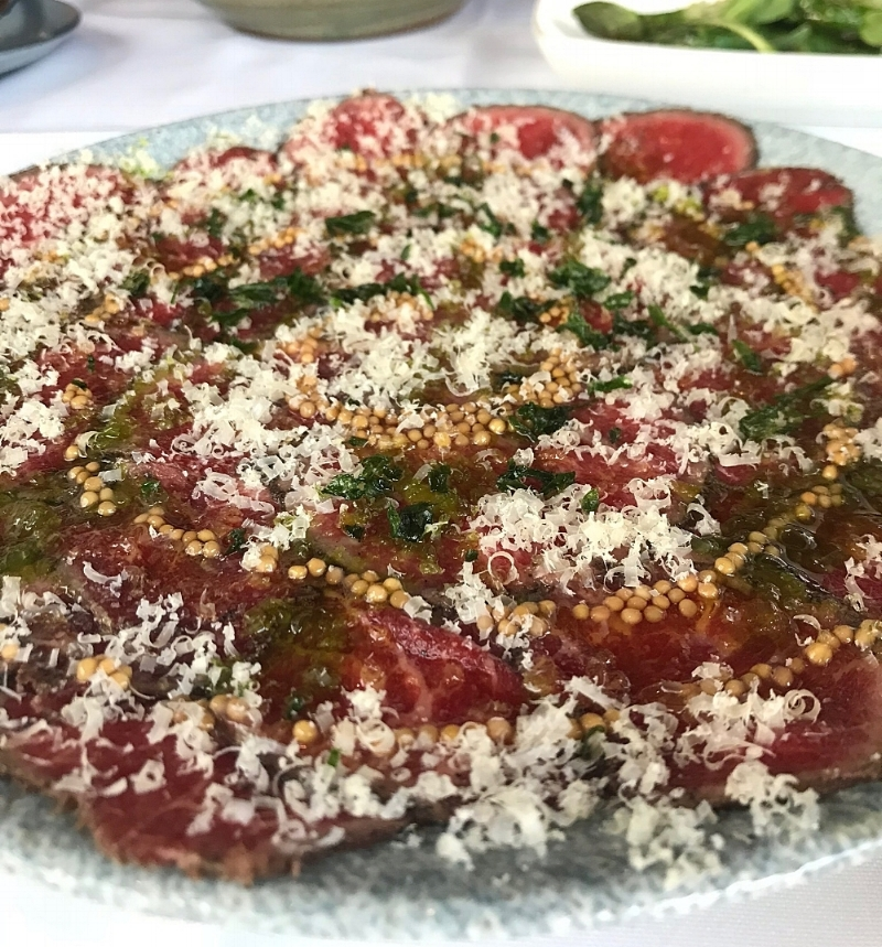 The  Carpaccio de Waygu  had raw Japanese waygu beef, fennel oil, slightly sweet mustard seeds, and mahon cheese. Again, the combination of flavors and textures here was amazing. The meat is soft and complimented by the fennel oil, while the mustard seeds added a hint of sweet and crunch. We would always recommend adding this to your list of tapas!