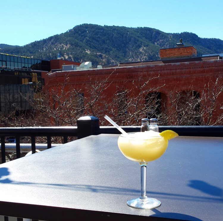 Why we love it: delicious margaritas, reasonably priced, fun vibe  Rio is also located in downtown Boulder. It offers a similar sprawling mountain view and some of our favorite margaritas (there is even a 3 marg limit because they're so strong!) They offer both 'on the rocks' and 'frozen' with a variety of flavors (Manberry, anyone?) Pair it with the complimentary chips and salsa and you have a match made in heaven! It's a really popular spot, so you will likely have to wait to find a table if you go during happy hour. They have a really fun vibe and we love that it's open til 10pm!