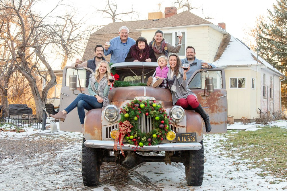 We took our family Christmas photo at the 1890s Farmhouse on their Studebaker!