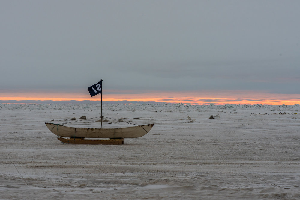 Traditional whaling boat made from sealskin drying on the sea ice. Photo credit: A. Torstensson
