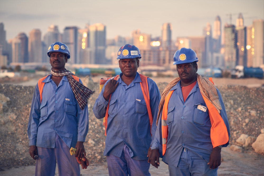 These guys were all smiles and eager to have their picture taken after a long day of work, until they put on serious faces when I raised the camera.