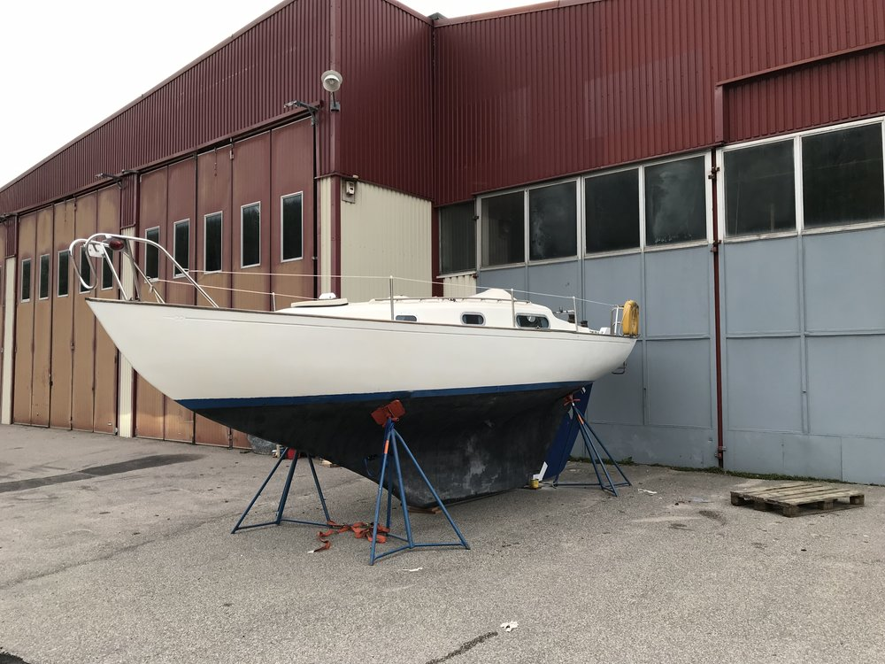 The Contessa 26 just after being lifted off the trailer. Adams Boat Care, Orust Sweden. Photo by: Daniel Novello
