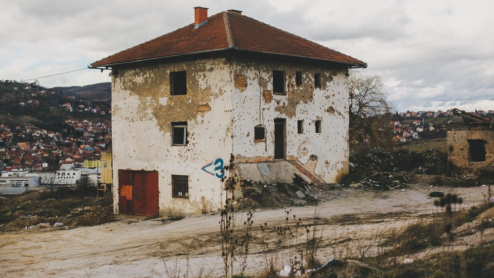 artillery fire ridden building on the outskirts of sarajevo. the scars and physical manifestation of an ineffable trauma. but so much potential remains.