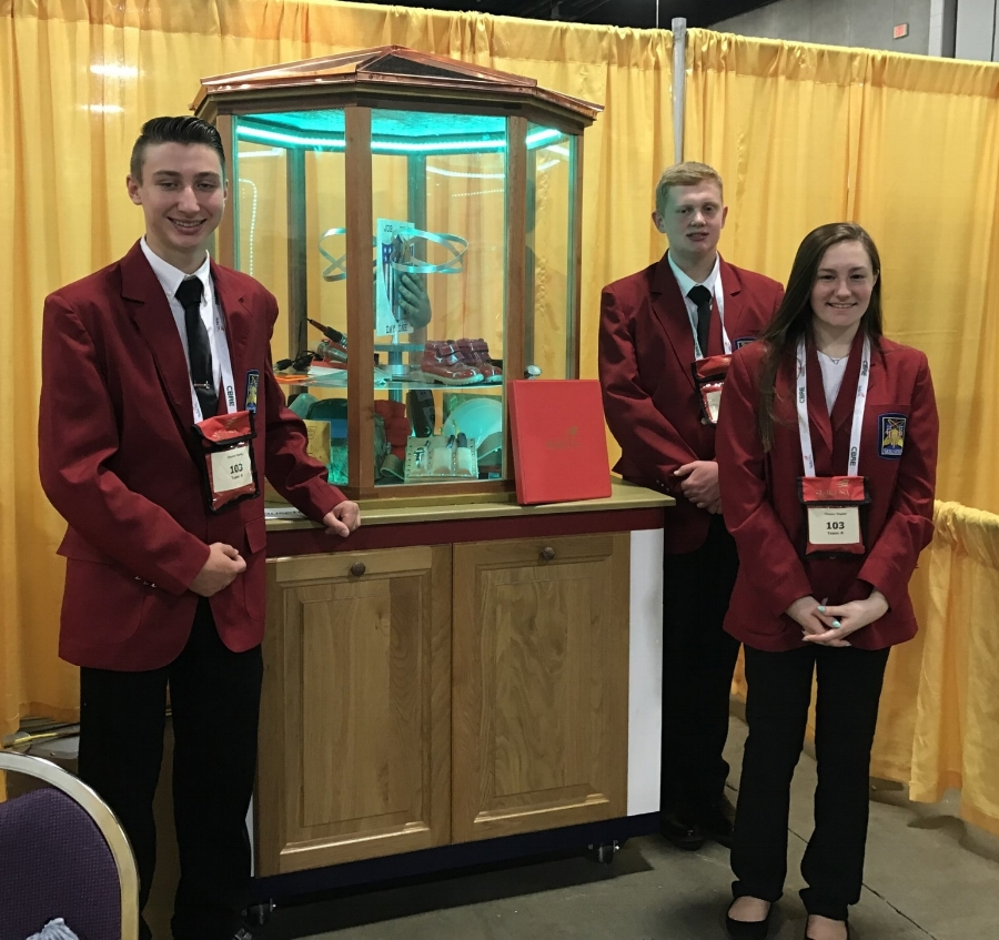 Left to right: Incoming seniors Ethan Rousseau, Adam Bellville and Kaitlyn Cook, all of Haverhill with their Chapter Display project.