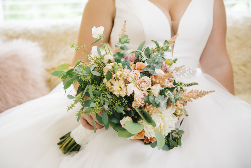Happily Ever Afters - View our highlights of local wedding day arrangements, bouquets, boutonnières, and more.