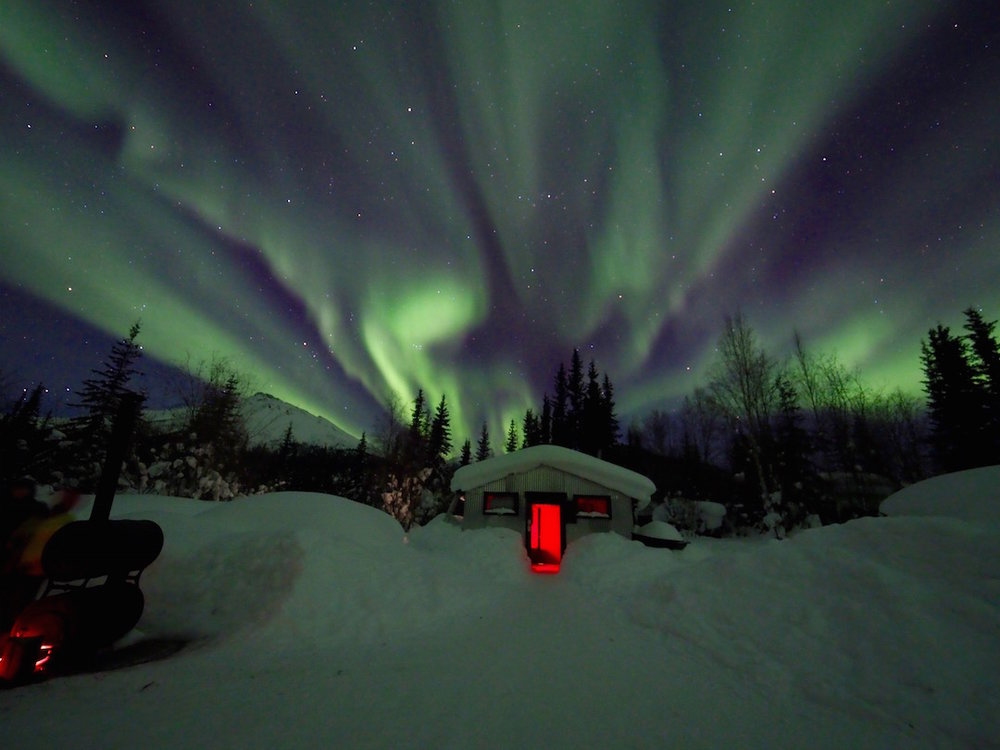 Northern Lights over a cabin in Wiseman (population 22) at Mile 188 of the Dalton Highway.