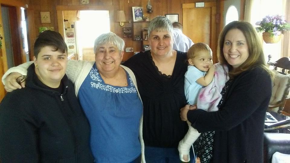 - Lori with her niece, her mom, her sister and holding her great niece, Sophia.