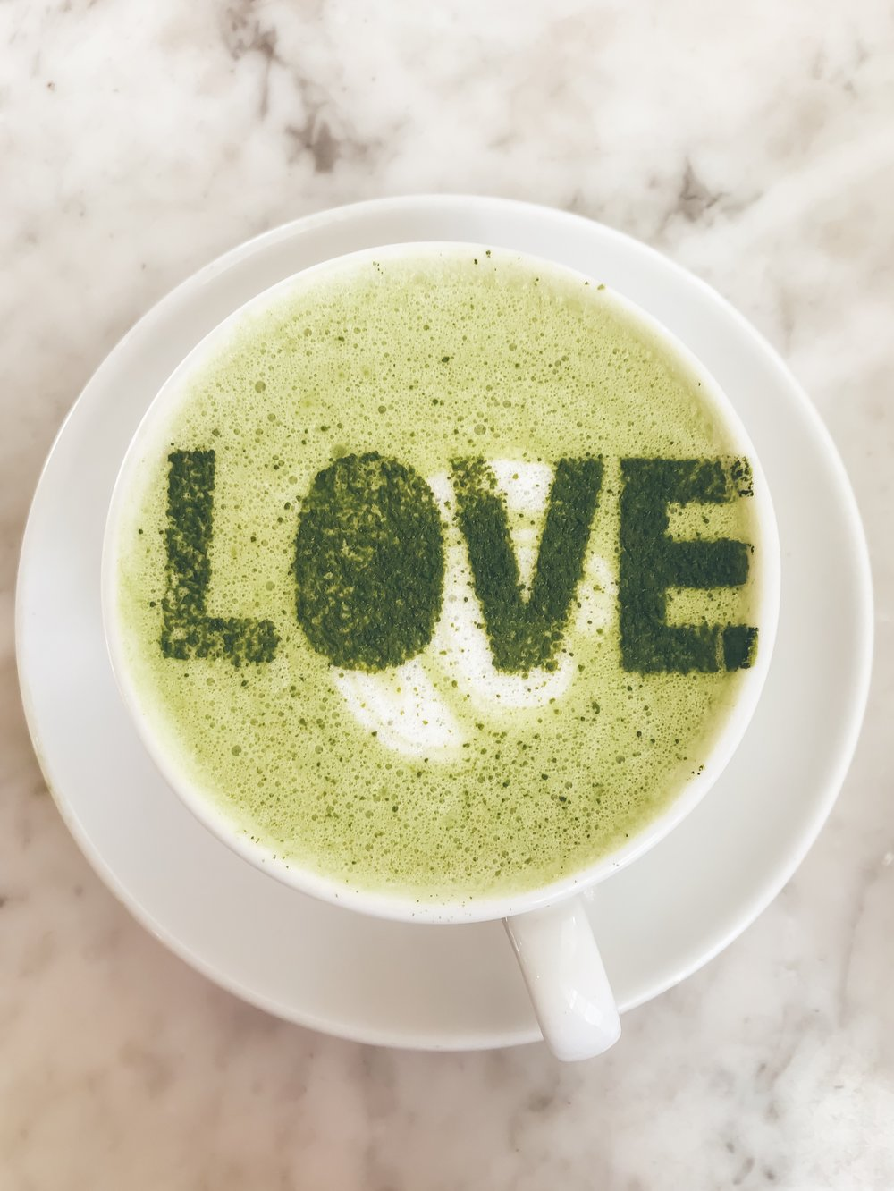 Matcha Latte - 2 teaspoons MatchaBar Ceremonial Grade Matcha4 oz. water1 cup unsweetened coconut milkDirectionsAdd hot water and matcha to Vitamix or blenderAdd stove-top warmed coconut milkStart blending on a low speed and gradually blend on a high speed until you see lots of foamPour and savor or listen to my morning tea meditation.