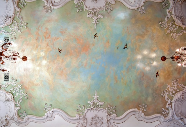 a ceiling mural transports you to another land