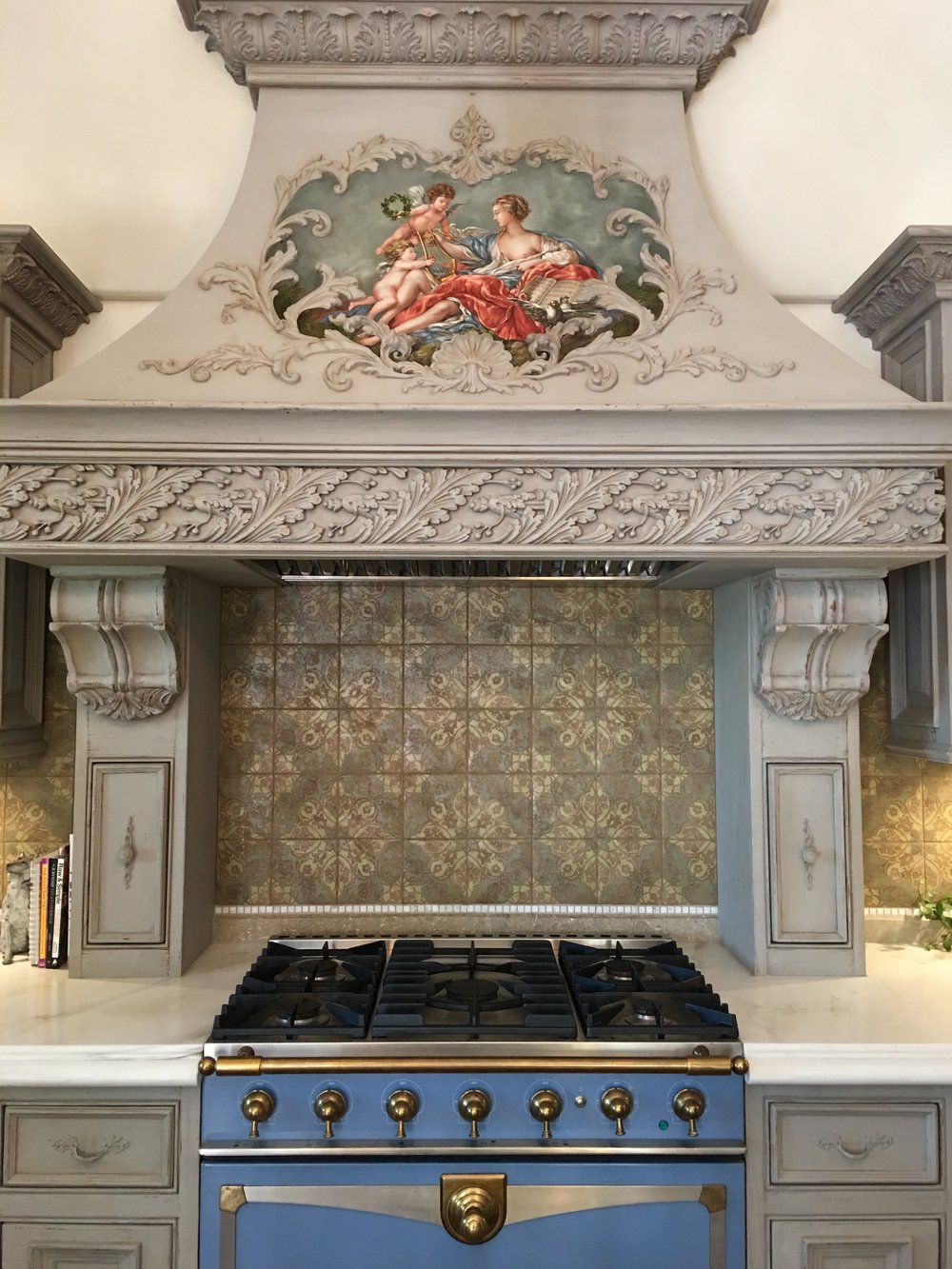 Oven hood adorned with a mural