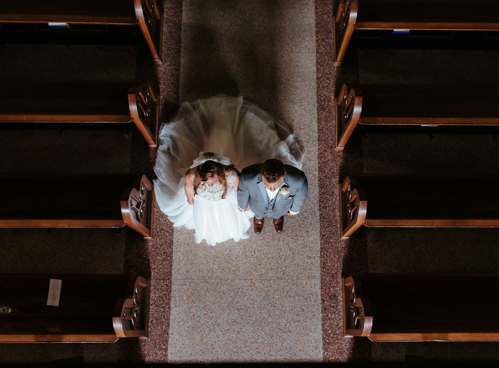 exiting a Catholic Church after ceremony, couple gets epic balcony shot