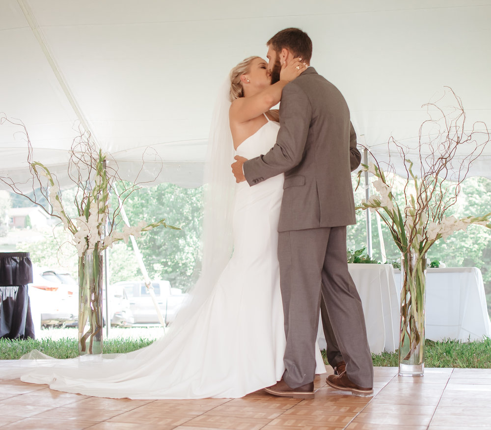 bride and groom say I do at surprise wedding in Indiana