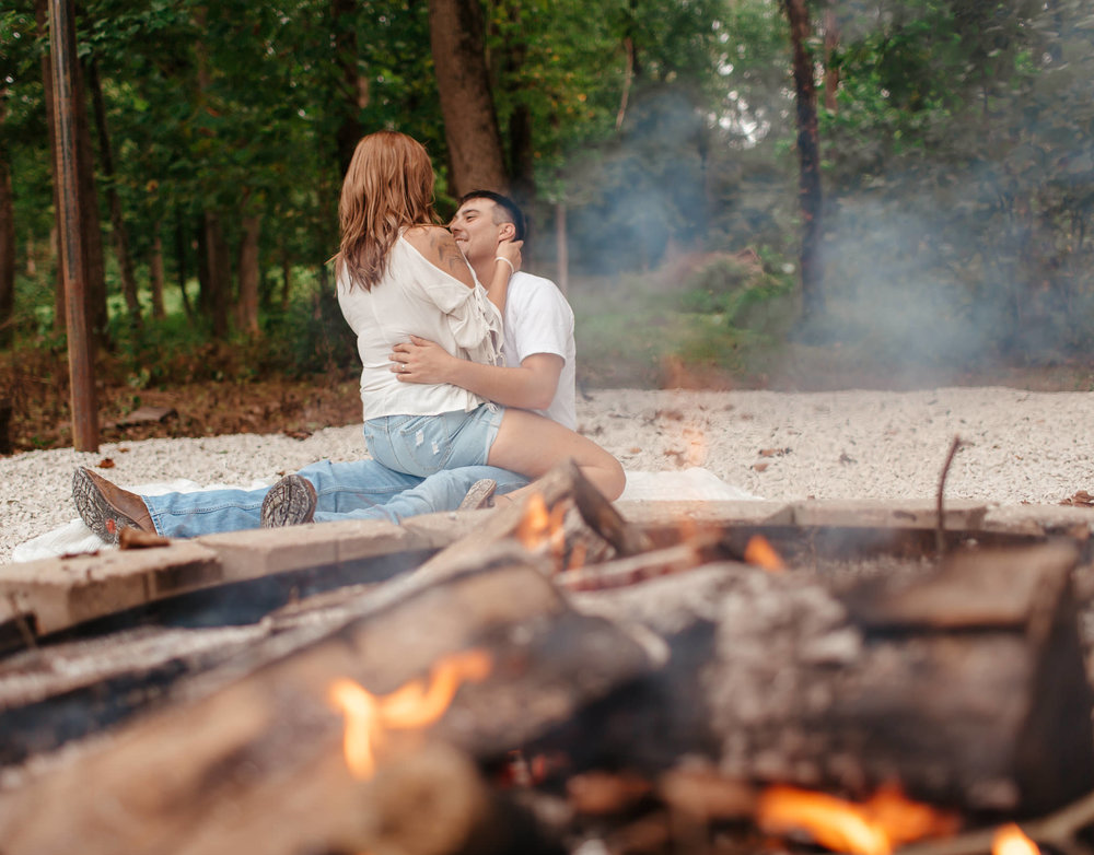 couple sitting together at a bonfire