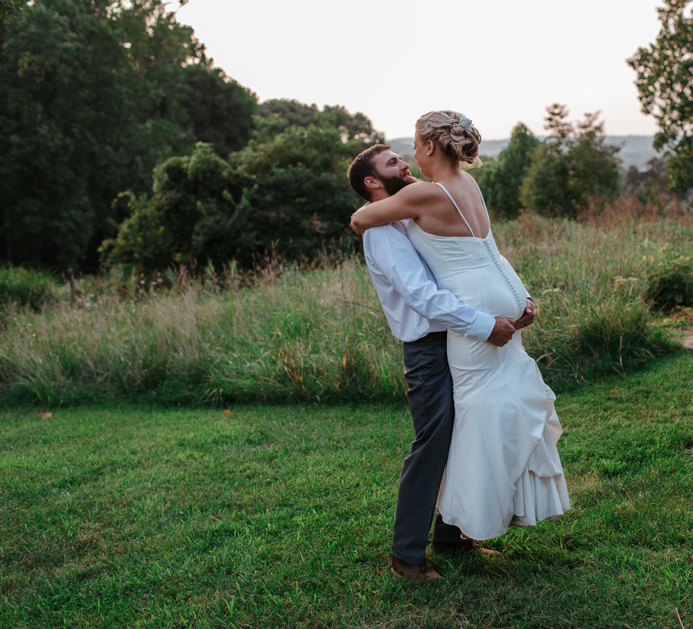 bride and groom share private first dance at sunset