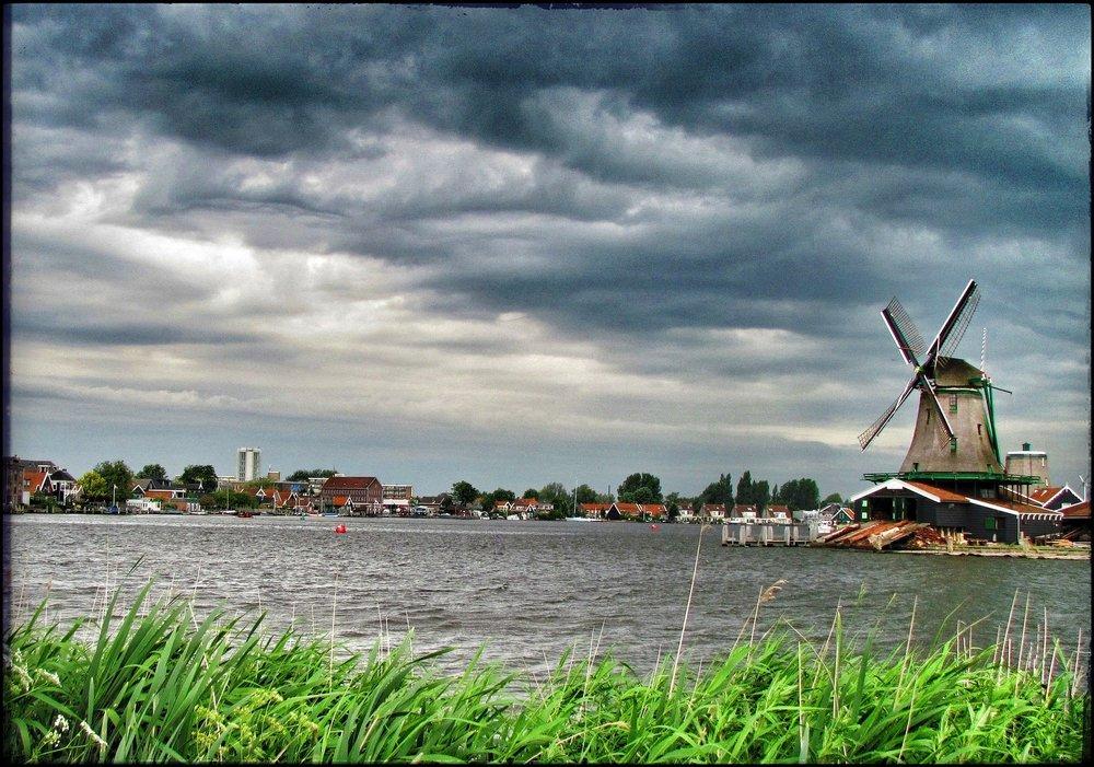 Windmills before a storm in Zaanse Schans.