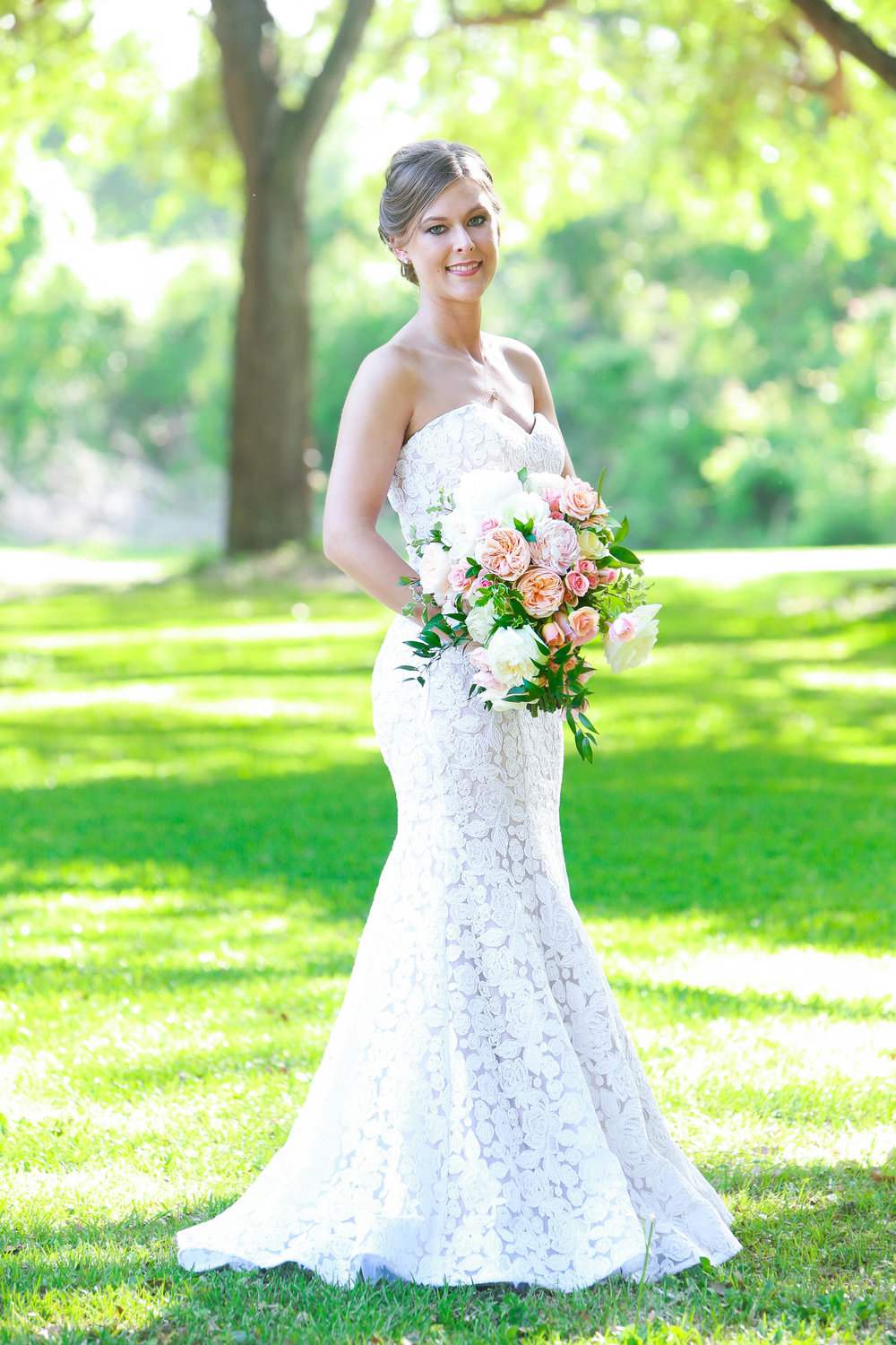 Classic bridal portrait with vibrant green colors in the background